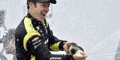 2019 INDYCAR Grand Prix winner Simon Pagenaud spraying champagne during his victory circle celebration after winning the Indianapolis Grand Prix on 11 May 2019.Photo by Chris Owens.