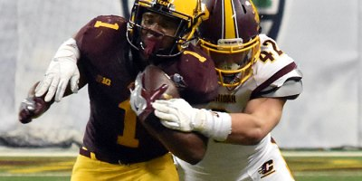 Central Michigan's Nathan Ricketts (42) attempts to haul down Minnesota running back Rodney Smith (1) during the 2015 Quick Lane Bowl in Detroit.Photo by Ian Shalapata.