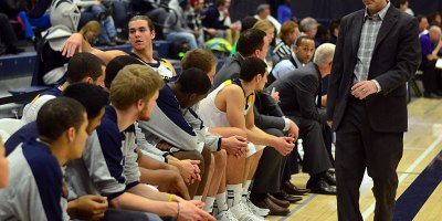 Windsor Lancers head coach Chris Oliver (R) addresses the bench during an OUA matchup with Laurier on 29 January 2014. Oliver announced his departure from the Lancers after 14 years at the helm, on 26 March 2019.Photo by Ian Shalapata.