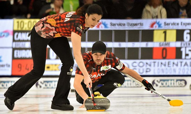Traditional mixed doubles partners, John Epping and Lisa Weagle were doubed up 8-4 by Switzerland's Melanie Barbezat and Peter de Cruz. Photos from Curling Canada's 2020 Continental Cup as part of the Season of Champions at the Western Fair Sports Centre in London, Ontario, on 11 January 2020. Ian Shalapata.