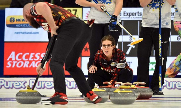 BJ Neufeld sweeps as Selena Njegovan shouts encouragement. Photos from Curling Canada's 2020 Continental Cup as part of the Season of Champions at the Western Fair Sports Centre in London, Ontario, on 11 January 2020. Ian Shalapata.