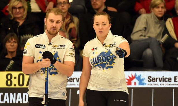 The reigning Olympic gold medalist Agnes Knochenhauer discusses strategy with Swedish national team second, Rasmus Wranå. Photos from Curling Canada's 2020 Continental Cup as part of the Season of Champions at the Western Fair Sports Centre in London, Ontario, on 11 January 2020. Ian Shalapata.