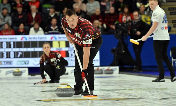 Rachel Homan looks on as Ben Hebert guides his rock down rink. The Canadian pair dropped a 10-2 result to Scotland's Eve Muirhead and Bobbie Lammie. Photos from Curling Canada's 2020 Continental Cup as part of the Season of Champions at the Western Fair Sports Centre in London, Ontario, on 11 January 2020. Ian Shalapata.