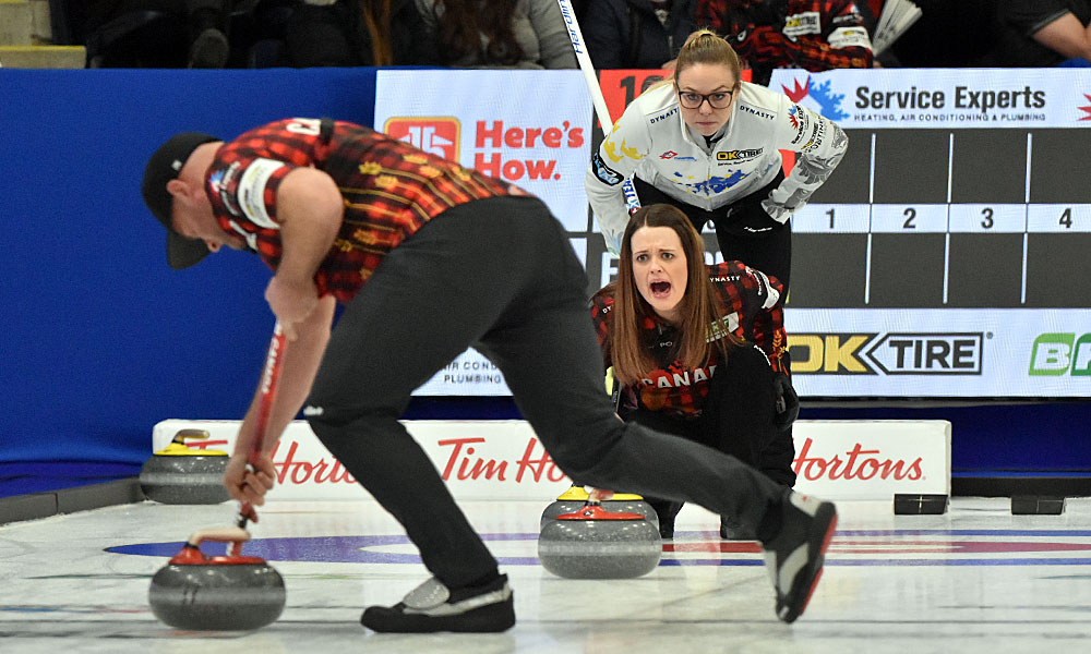 Tracy Fleury urges on Darren Moulding as Alina Paetz watches at Curling Canada's 2020 Continental Cup as part of the Season of Champions at the Western Fair Sports Centre in London, Ontario, on 11 January 2020. Ian Shalapata.