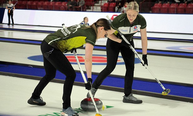 Ashley Sippala (L) and Jen Gates of Team Northern Ontario guide the rock down rink during Draw 1 play at the 2020 Tournament of Hearts in Moose Jaw, SK, on 15 February. Along with Kendra Lilly and skip Krista McCarville, Northern Ontario defeated Team Canada 8-3 in nine ends. (Photo by Rob Gandhu)
