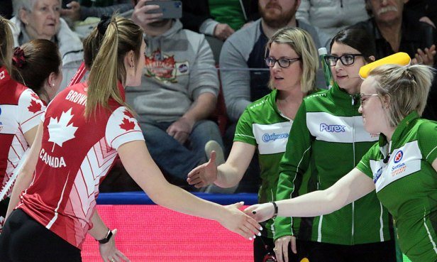 Jessie Hunkin (R) of Saskatchewan congratulates Canada's Rachel Brown as Stefanie Lawton and Kara Thevenot look on. Canada scored two in each of the last two ends to defeat SK 9-6 in the 4th draw at the 2020 Tournament of Hearts in Moose Jaw, SK. (Photo by Rob Gandhu)