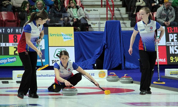 Ashley Klymchuk (L) and Dezaray Hawes wait to sweep a shot from Erin Pincott during BC's draw against the Northwest Territories on 16 February at the 2020 Tournament of Hearts. The trio along with skip Corryn Brown defeated NWT 8-5 for their second win in Pool B. (Photo by Rob Gandhu)