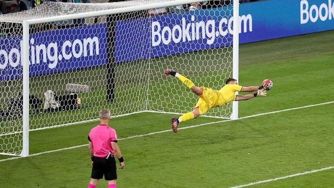 Euro 2020 player of the tournament Gianluigi Donnarumma stops a penalty kick by England's Bukayo Saka to ensure Italy's victory. Source: UEFA.